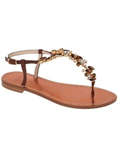 Brown leather sandals from Caruso featuring a gold embellished t-bar, an ankle buckle fastening and a flat sole.
