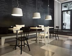Just the simple not easy design J'adore: Altro Quartz Tile lends itself to this simplistic cafe interior.