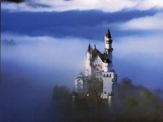 Neuschwanstein Castle was built in the Romanesque Revival style and was the inspiration for Disneyland's Sleeping Beauty castle.