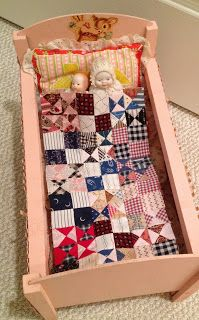 Sweet vintage pink doll bed and quilt.