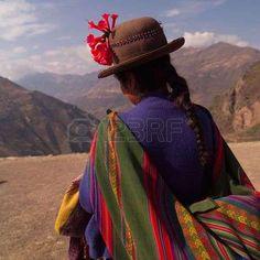 ruins of pisaq - temple of the sun in peru peruvian woman in traditional dress Фото со стока