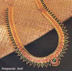 Nagapada  Thali   (traditional Kerala jewelry)