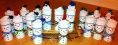 Snowmen made from Crystal Light cans covered in card stock.  I used children's socks for hats.  These are great for holding crayons, pens, pencils, scissors, q-tips, cotton balls.....  You could make a whole family using various sizes of cylinders.  (Big oatmeal can for dad, smaller oatmeal can for mom and crystal light cans for kiddos.)