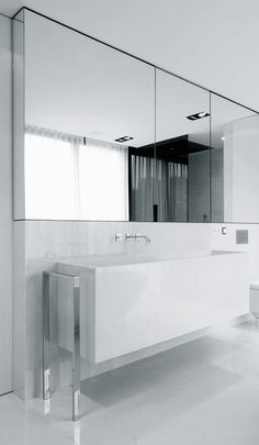 | BATHROOM | lovely detail of mirror with integrated storage cabinetry flush with backsplash and continuous finish on returns. Ensemble -one stop office | Project Q te K