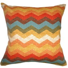 This cheerful and colorful throw pillow is an ideal accent piece in your home. This square pillow features the color palette of Autumn in red, orange, white, yellow, blue, green and brown. The zigzag print pattern of this decor pillow creates an upbeat vibe.