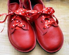red shoes with polka dot laces