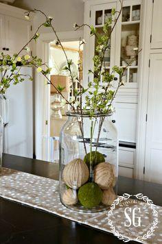 Spring Jar decorating: jar, moss and burlap balls, spring branches. From stonegableblog.com
