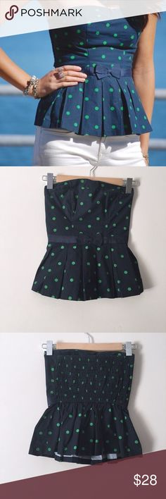 """[Abercrombie & Fitch] Peplum Strapless Top Abercrombie & Fitch Navy Blue Sleeveless Peplum Top. Stretch Banding Back, Fitted Peplum with bow at Front and Green Polka Dots. Pleated Peplum. Sweet Heart Neckline. Tube Top. 100% Cotton. very Stretchy.   Measurements are Flat Across.  ▪️Pit to Pit: 16"""" (stretched out) ▪️Length: 16"""" ▪️Hips: 21"""" (stretched out) ▪️Waist: 14"""" (stretched out)  ▪️Condition: New with Tags.  ▪️Retail: $48.00 #241112162 Abercrombie & Fitch Tops"""