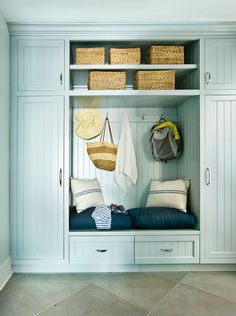 Lovely built-in mudroom area with painted beadboard cabinet doors. Small bench with 2 cushions is sandwiched between storage cabinets perfect for hiding sporting equipment and jackets. Luxury Interior Design, Home Interior, Mudroom Cabinets, Storage Cabinets, Cabinet Doors, Hallway Decorating, Home Renovation, Home Projects, Decoration