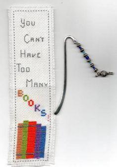 Books and a tiny yarn charm.