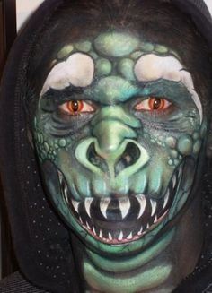 Face Painting Competition Colourfest 2009 Model: Nikora Artist: Hayley Marlow Model is wearing a black hoodie, hair tyed back, red and black contacts an. Face Paint - My Dragon Dinosaur Face Painting, Monster Face Painting, Dragon Face Painting, Eye Painting, Face Painting Images, Face Painting Designs, Horror Makeup, Scary Makeup, Comic Makeup