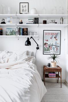 To add storage space to a small bedroom, install shelves above the bed to display collectibles or art or hold books.
