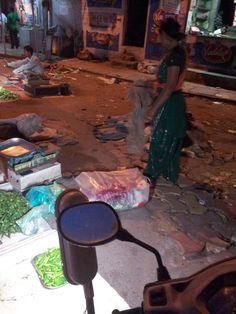 Vegetable vendor cleaning her own space.