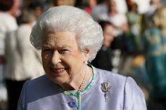 Queen Elizabeth II smiles during a visit to the Chelsea Flower Show on press day on May 19, 2014 in London,