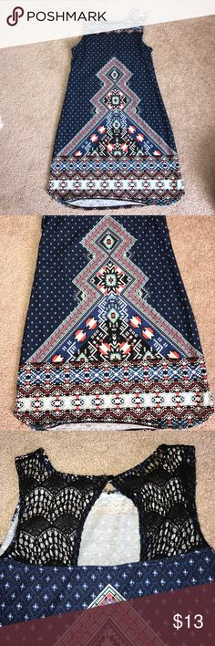 Tighter loose fit tribal dress The dress is loose but still comes down tighter around legs/hips. Super comfy. Double strap. Super colorful. Tribal design. Top back is lace with small cut out. Only has been worn once. Great condition Xhilaration Dresses Mini