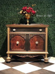 """Hello Pandora. This dark and sophisticated sideboard is refinished in mahogany wood tones. General Finishes Lamp Black and a custom blend of Modern Masters Inc. Pale Gold and Blackened Bronze. Fabulous condition considering its antique age!"" - Revive in Style"