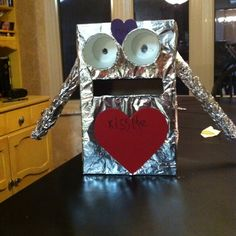 Robot valentine box made from Nike shoe box, paper cups, aluminum foil, and the foil tube.