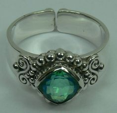Sterling Silver Ring with  DOUBLET RAINBOW PERIDO CB CUT stone (AJRG06) Specifications:  Silver wt. in gm : 7.80 Stone wt. in gm : 0.334 Gross Wt. in gm: 8.134