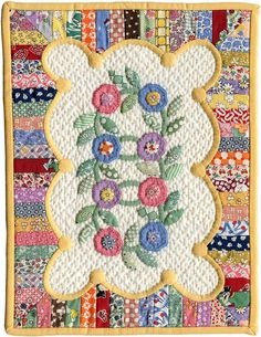 So many things to love about this quilt... Use of 30s fabrics, colors, applique, unusual design, quilting... Beautiful!