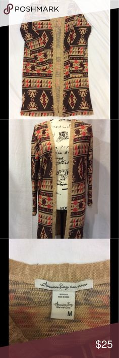 American Rag long drape cardigan Earthy tone lightweight cardigan with a tribal design. Open front and drapes beautifully. It will be a Fall hit! American Rag Sweaters Cardigans