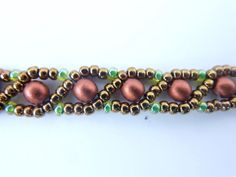 DIY Jewelry: FREE beading pattern for an 18x25mm cabochon netted bezel with Russian Snake chain, made with 11/0 and 15/0 seed beads, and 4mm copper pearls.