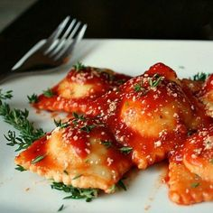 A delicious homemade ravioli stuffed with ricotta cheese, spinach and mushrooms, then tossed in a simple marinara sauce.