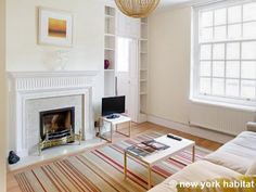 Excellent natural light enters this apartment through the many windows and highlights the light natural hardwood flooring that is found throughout the apartment http://www.nyhabitat.com/london-apartment/vacation/1503