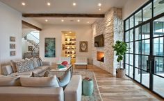 The back of the home has a view of a coarse landscape, refined and reflected in the interior of the home with its stone accents and exposed ceiling beams. Description from homedsgn.com. I searched for this on bing.com/images
