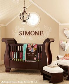 There's no doubt about it 'Simone' is quite happy in this lovely baby nursery. I love the personalized wall letters and the beautiful chandelier that goes so well with the dark wood furniture. Adorable baby nursery decor ideas compliments of Pottery Barn Kids.