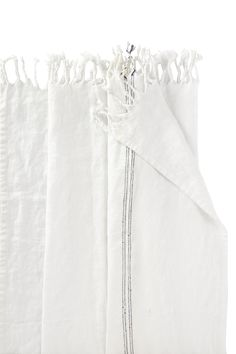 Luxe white linen throw creates a sense of space. Pure natural fabric with a navy ticking stripe offset by a white tassel trim for easy informality. <ul> <li> Machine Wash Gentle</li> </ul>
