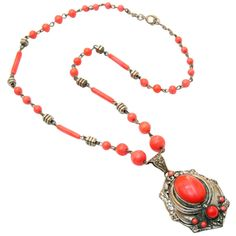 1930s Coral Art Deco Pendant, silver-toned with coral cabochon center.