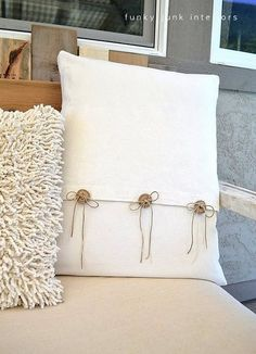 diy pillow made out of painters cloth and using your homemade wood buttons listed on