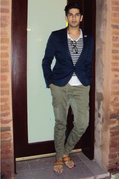 For an everyday outfit that is full of character and personality pair a deep blue blazer with olive cargo pants.  Shop this look for $70:  http://lookastic.com/men/looks/navy-blazer-and-white-v-neck-t-shirt-and-olive-cargo-pants/215  — Navy Blazer  — White Horizontal Striped V-neck T-shirt  — Olive Cargo Pants