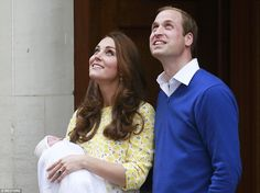 The new parents smile adoringly for the hundreds of people that turned out to catch that f...
