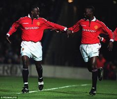 Cole (right) celebrates with Yorke after the Trinidadian struck United's second against Chelsea