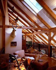 Timber frame home balcony with skylights
