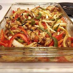 boneless, skinless chicken breasts, cut into thin strips 2 Tbsp vegetable oil 2 pkg of mccormick fajita seasoning 1/2 tsp garlic powder 1/4 tsp seasoning salt 1can diced tomatoes w chilies onion, sliced red bell pepper, cut in strips green bell pepper, cut in strips oven to 400 degrees. Place chicken strips in a greased baking dish.Toss veg w oil n seasoning n bake 30 min.