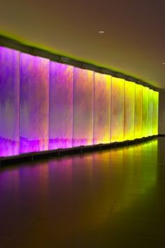 A stunning colour-changing glass-LED wall in a reception area.