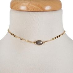 """Dainty gold tone choker with a gray stone focal. Approximately 12"""" in length."""
