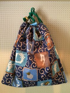 Kinchaku - Japanese style handy sack. Whirlpool pattern on the blue gives a strong impression.