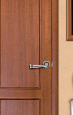Juego de manillas modelo 33t3-18 en acabado Niquel Mate combinado con Bronce sobre una puerta de Madera Caoba de un salón.