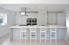 My kitchen! Wish it was always this tidy :-). White oiled engineered wide oak floor boards. Work surfaces are white Corian and full stave oak, timber inframe kitchen painted in pavilion grey with polished nickel furniture