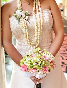 I wanna wear a lei for my wedding-I'm kinda liking this style- pikake leis for the bride