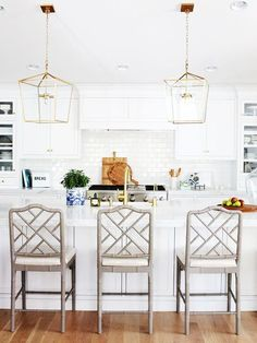 There's a reason why this easy kitchen color scheme is always makes an impact. These white kitchens will make you want to brighten up your home.