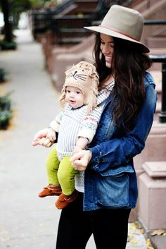 wow hipster baby with that lion hat and neon pants.