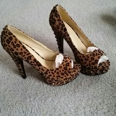 $13 TODAY ONLY Spike stud cheetah leopard heels Peep toe cheetah leopard heels with spikes . 2 spikes are missing but not where it's noticeable (last photo shows where) . Shoes Heels
