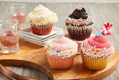 These delicious Chocolate, Vanilla and Strawberry frosted cupcakes come together in perfect harmony with an elegant sugar flower placed on top. Strawberry Frosting, Cupcake Frosting, Cupcake Delivery, Mothers Day Cupcakes, Buckwheat Cake, Recipe For Teens, Flower Cupcakes, Delicious Chocolate, Decadent Chocolate