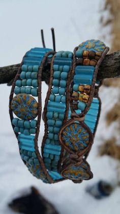 A natural leather triple wrap leather bracelet