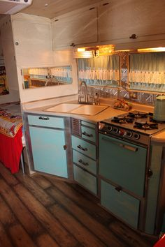 Turquoise and leopard kitchen in my vintage trailer