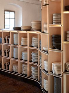 Equipping the kitchen with proper and more organized plates and utensils rack. A wooden rack adds on to the whole concept of the wooden-theme. A slight touch of the theme in the kitchen to give the kitchen a more enhanced look.